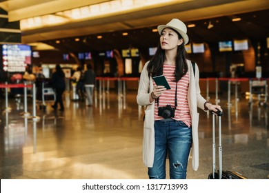 Pretty asian woman get holiday. charming beautiful girl decided going to place at foreign oversea country. Attractive lady feel happy relaxed wait for calling flight at airport lobby holding passport