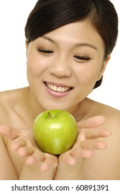 Pretty asian woman with green apple isolated over white