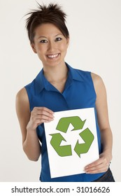 Pretty Asian Woman holding up a Recycle sign