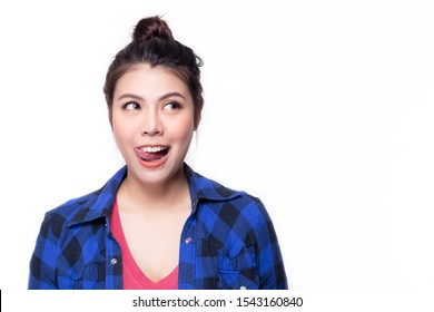 Pretty asian woman licking her lips when see some appetizing, delicious food, sweet, yummy food. Attractive beautiful young woman want to eat delicious meal, get hungry and get drooling of appetizer