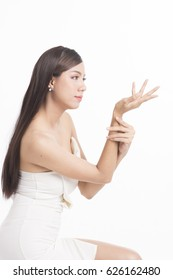 Pretty asian woman portrait with long straight hair on white background, posing of hand holding or showing something