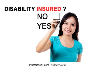 Pretty Asian woman using a pen while answering a yes option with a question of disability insured on the whiteboard