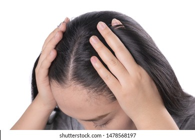 Pretty Asian women itching,scratch about problem hair loss,head bald,lice,dandruff.hair loss problem and Hair treatment concept