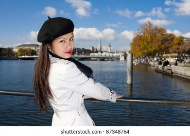 pretty asian in zurich, with the lake, a tram and two famous churches in the background