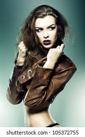 pretty attractive erotic woman in brown jacket