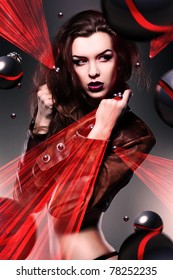 pretty attractive erotic woman in brown jacket with laser light