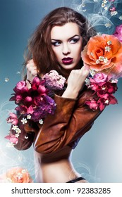 pretty attractive erotic woman in brown jacket with big flowers