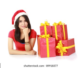 pretty attractive young girls smiling with a lot of christmas gift isolated on white background.