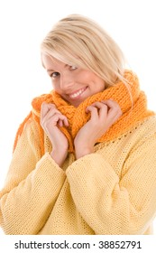 Pretty autumnal woman wrapped orange scarf smiling isolated on white background