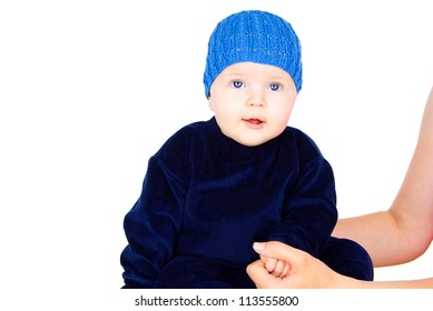 pretty baby in a blue cap