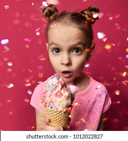 758d0ee8d74c Pretty baby girl kid holding ice cream in waffles cone with raspberry  showing surprised on red