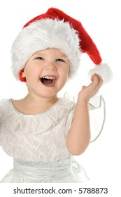 pretty baby in santa claus christmas red hat over white background