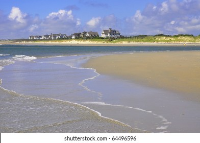 Pretty Beach Scene with Oceanfront homes in the distance