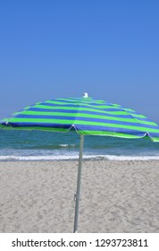 Pretty beach umbrella at the seashore.