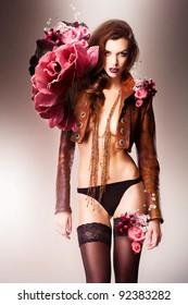 pretty beautiful erotic flower woman in panties and brown jacket