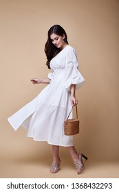 Pretty beautiful sexy elegance woman skin tan body fashion model glamor pose wear trend dress casual clothes party summer collection makeup hair style brunette success accessory jewelry studio.