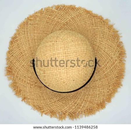 Pretty beautiful straw hat with black ribbon and bow on white background ab5ae00a5f1