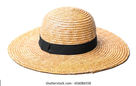 Pretty beautiful straw hat with ribbon and bow on white background beach hat from a side view isolated
