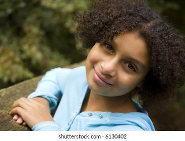 pretty biracial girl in an outdoor setting