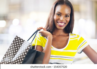 pretty black lady shopping in mall
