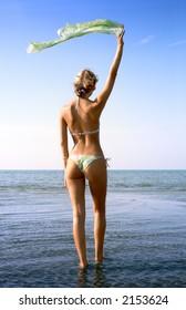 pretty blond in bikini with green scarf in water