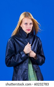 Pretty blond teen on a blue background