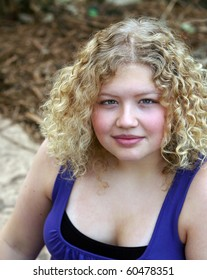 pretty blond teenage girl with curly hair
