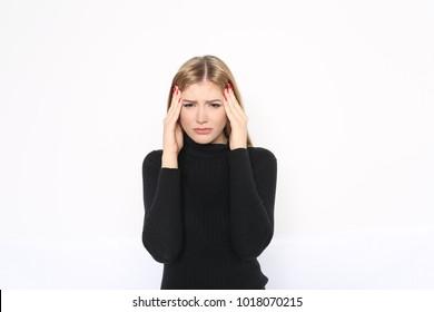 Pretty blond woman with headache