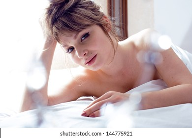 pretty blond woman laying in bed