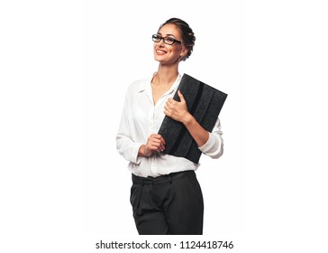 Pretty Blond Young Office Woman Hugging a Gray Documents Folder and Smiling, happy businesswoman with eyeglasses with laptop case in hand. Dressed in wgite blouse