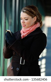 Pretty Blond Young Woman Texting On A Smartphone Mobile