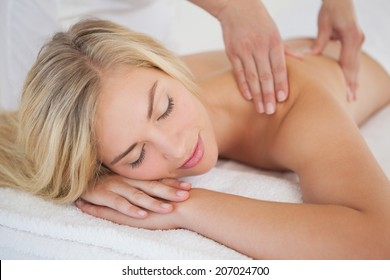 Pretty blonde enjoying a massage at the health spa