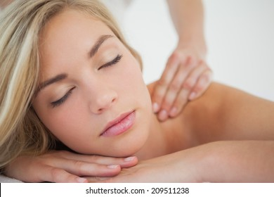 Pretty blonde enjoying a massage at the health spa