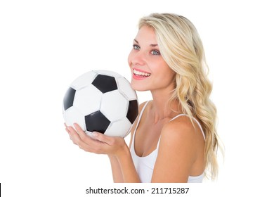 Pretty blonde football fan holding ball on white background