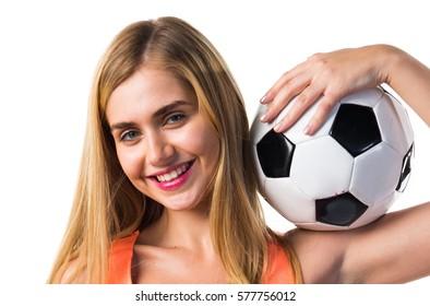 Pretty blonde girl holding a soccer ball