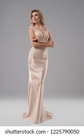 Pretty blonde in luxurious evening dress shot