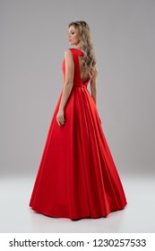 Pretty blonde in luxurious red evening dress shot