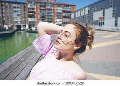 Pretty blonde model enjoying a sunny day in the city