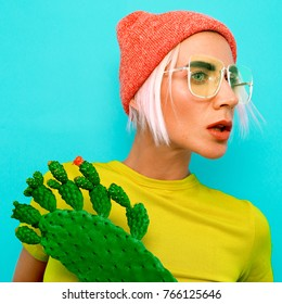 Pretty Blonde Model in stylish accessories. Beanie and glasses. Fashion bright look