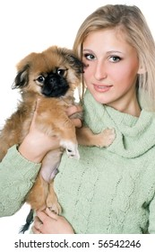 Pretty blonde posing with a pekinese puppy. Isolated on white