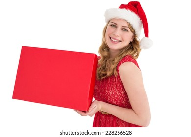 Pretty blonde in red dress holding a box on white background