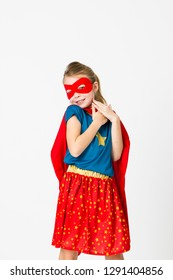 pretty blonde supergirl with red cape