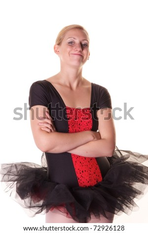7be2bd7af Pretty blonde teenage girl in black and red ballet costume pulling funny  face. Photographed against