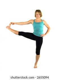 Pretty blonde woman doing yoga to relax, stay healthy, and get flexible