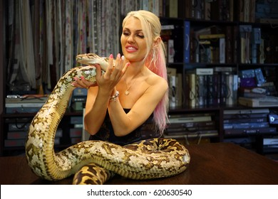 Protest Burmese python with nude girl consider