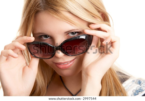 Pretty blonde woman with sun glasses on white background