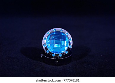 Pretty Blue Faceted Jewel With Silver Surround