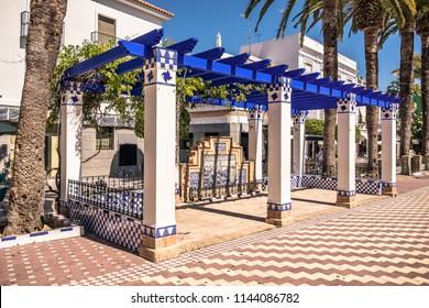 Pretty blue and white pergola in Laguna Square plaza, Ayamonte, Huelva Province, Andalucia, Spain.