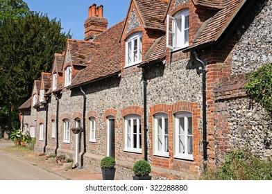 Pretty brick and flint cottages with dormer windows along a village street, Hambledon, Oxfordshire, England, UK, Western Europe.