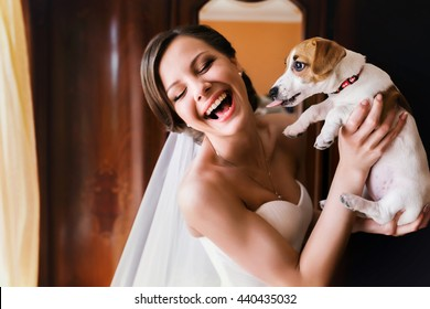 Pretty bride has fun while she plays with a dog